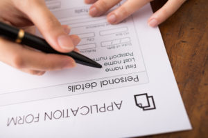 Woman filling out credit application
